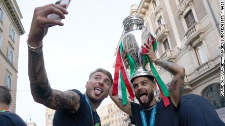 Ciro Immobile and Lorenzo Insigne celebrate with the Euro 2020 trophy.