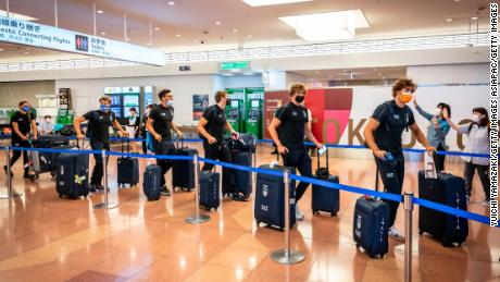Members of Italy's Olympic delegation arrive in Tokyo.