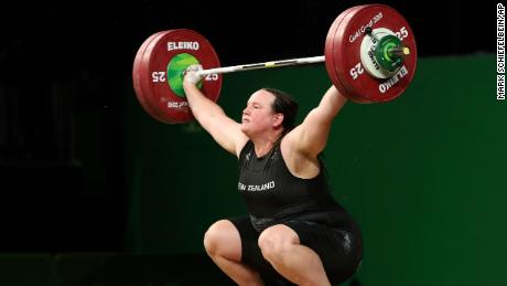 In this April 9, 2018 file photo, New Zealand's Laurel Hubbard lifts in the snatch of the women's +90kg weightlifting final at the 2018 Commonwealth Games on the Gold Coast, Australia.