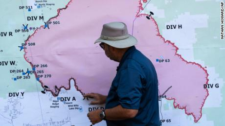 Operations Section Chief Bert Thayer examines a map of the Bootleg Fire on Tuesday in Chiloquin, Oregon.