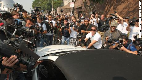 Photographers mob Britney Spears' car in October 2007 as she arrives at family court for a hearing to work out custody arrangements with her ex-husband Kevin Federline.