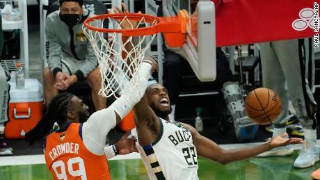Milwaukee Bucks forward Khris Middleton (22) drives around Phoenix Suns forward Jae Crowder (99) during the second half of Game 4 of basketball's NBA Finals.
