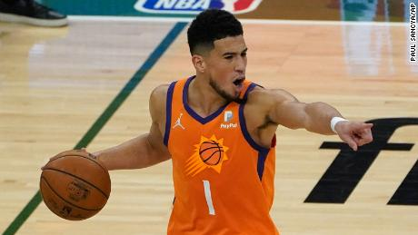 Phoenix Suns guard Devin Booker (1) directs teammates during the first half against the Milwaukee Bucks in Game 4.