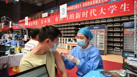 Students line up to receive the Covid-19 vaccine at the Inner Mongolia University of Technology on April 13 in Hohhot, Inner Mongolia.