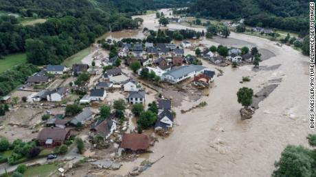 European officials say 'climate change has arrived' as deadly floods engulf entire towns
