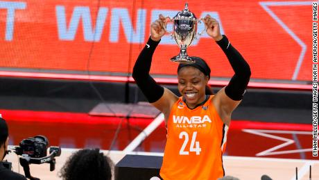 Arike Ogunbowale holds up the MVP trophy after dropping 26 points in the WNBA All-Star Game.