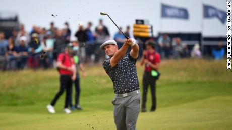 DeChambeau plays his approach shot from the 18th fairway during his first round of The Open.