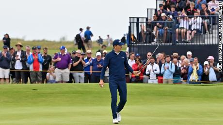 Spieth reacts after making his birdie putt on the 15th green during his first round of The Open.