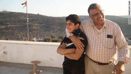Nishat Al Aqtash on his rooftop overlooking Beita, West Bank.