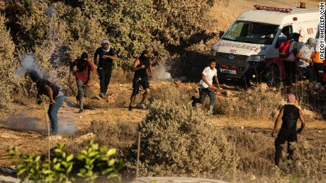 Young Palestinians in clashes with Israeli soldiers, in Beita on July 2.