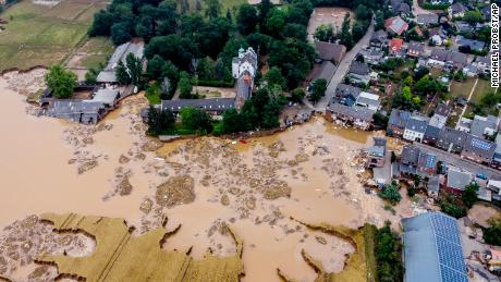 A damaged castle, left, is seen in Erftstadt-Blessem, Germany, Saturday, July 17, 2021.