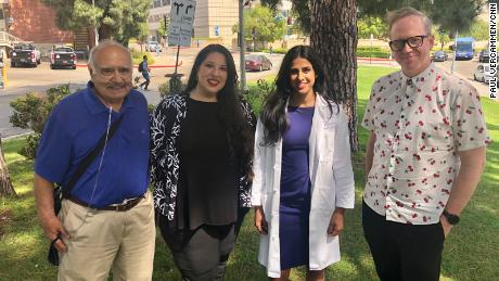 Marcelo Olavarria, left, and Jeff Sweat, right, stand with the therapists helping them learn to breathe again: opera singer Nani Sinha and pulmonologist Dr. Nida Qadir.