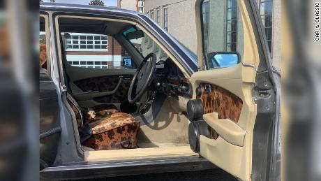 The auctioneer said the four-door luxury car was retrimmed in a cow hide pattern throughout.