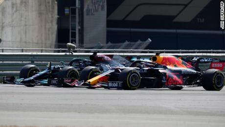Hamilton and Max Verstappen take a curve side-by-side at the start of the British Grand Prix.