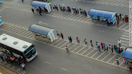 People wait for buses at a bus station in Rwanda's capital Kigali on July 1.