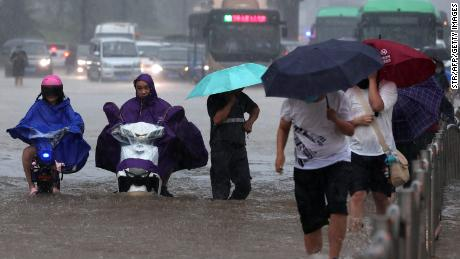 Passengers trapped inside submerged subway as deadly floods sweep central China