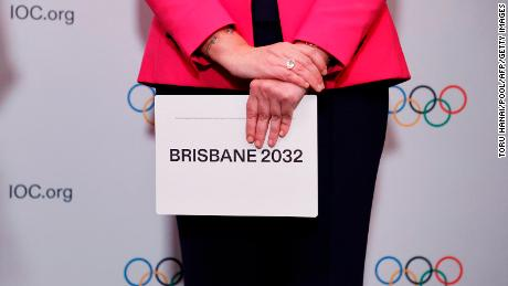 Queensland Premier Annastacia Palaszczuk holds a queue card after Brisbane's announcement at an IOC session in Tokyo.