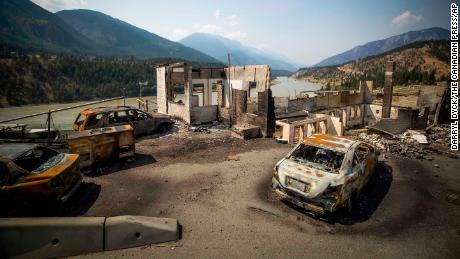 Burned cars and structures are seen in Lytton, British Columbia, on Friday, July 9, 2021.