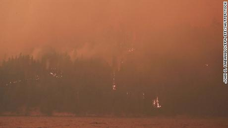 Heavy smoke and flames on the west side of Butte Valley Reservoir from the Dixie fire in Plumas County, California, on July 21.