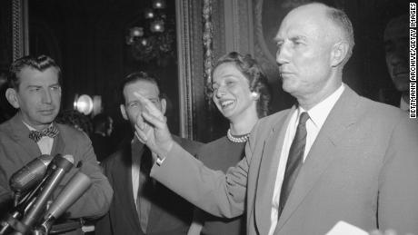 Sen. Strom Thurmond is surrounded by reporters as he steps from the Senate Chamber after ending his 24-hour filibuster  against the Civil Rights Bill of 1957.