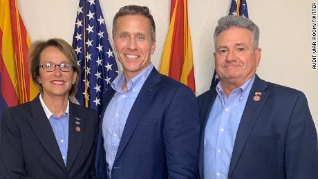 Former Missouri Gov. Eric Greitens, (center) now running for a US Senate seat, poses with Arizona state senators Wendy Rogers and Sonny Borrelli before his June 12 tour of the Arizona Senate's audit site.