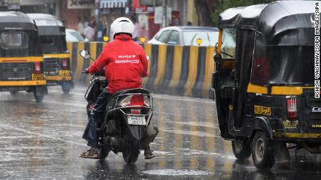 Zomato shares soar in red-hot start for first Indian unicorn to go public