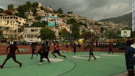 Men playing basketball in Port-au-Prince. Thousands have fled their homes in the capital since June.