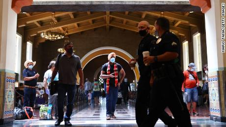 People wear face coverings at Union Station in Los Angeles on Monday, July 19.