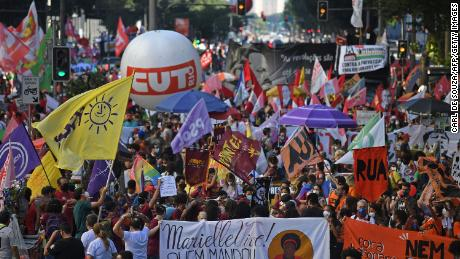 Demonstrators take part in a protest against Bolsonaro's government in downtown Rio de Janeiro on July 24.