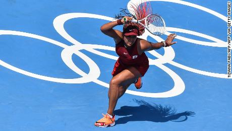 Osaka hits a forehand as she makes a winning start to the Tokyo Olympics.