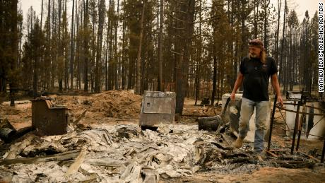 Scott Griffin surveys his property which was destroyed by the Bootleg Fire, in Sycan Estates, Oregon, U.S on July 24.