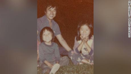 """Il Man """"Tony"""" Heo is pictured with his two children in 1977 or 1978."""