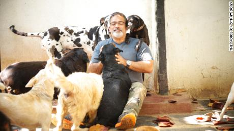 Rakesh Shukla at the VOSD sanctuary with a few of his dogs.