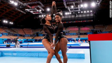 Simone Biles poses for pictures with her teammate Jordan Chiles at the 2020 Summer Olympics, in Tokyo, Japan.