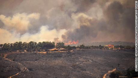 Wildfires scorch Spain and cause 'disaster without precedence' in Sardinia