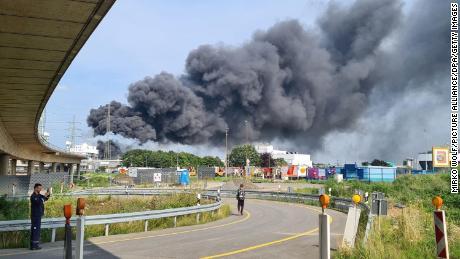 A dark cloud of smoke rises above the Chempark site.