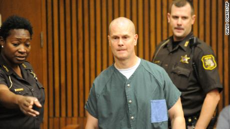 Wershe, 46 at the time, is escorted into a Detroit courtroom in September 2015.