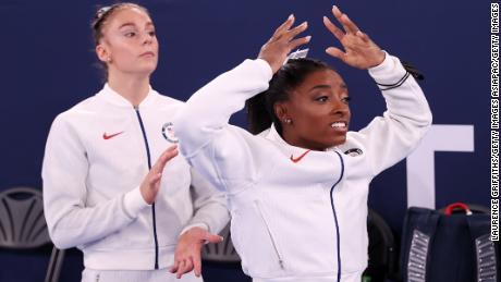 Grace McCallum (left) and Simone Biles react during the women's team final.
