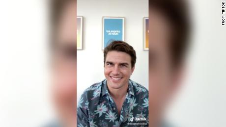 Tom Cruise isn't really grinning here — it's a deepfake video posted to TikTok earlier this year.