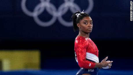 Simone Biles, of the United States, waits to perform on the vault during the artistic gymnastics women's final at the 2020 Summer Olympics, Tuesday, July 27, 2021, in Tokyo.