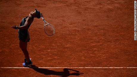 Naomi Osaka serves the ball to Romania's Patricia Maria Tig during their women's singles first round match on Day 1 of the French Open tennis tournament in Paris on May 30, 2021.