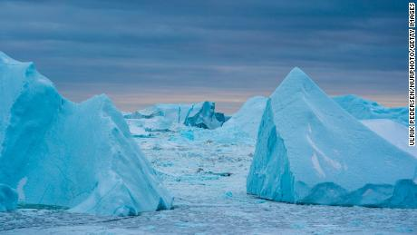 Icebergs are shown near Ilulissat, Greenland. The climate crisis is impacting the Greenland ice sheet.