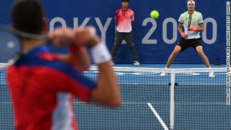 Alexander Zverev waits to return the ball against Djokovic.