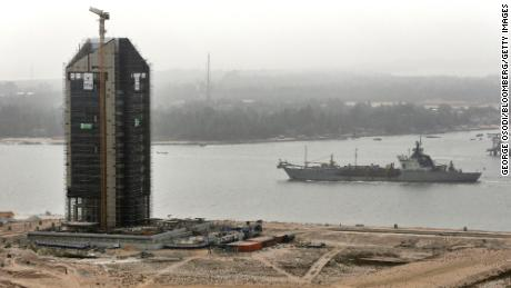 A cargo ship passes along a waterway during construction at the Eko Atlantic city site in February 2016.