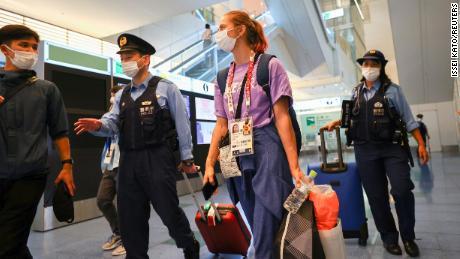 Belarusian athlete Kristina Timanovskaya is escorted by police officers at Haneda international airport in Tokyo, Japan August 1.