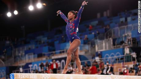 Biles competes on the balance beam during women's qualification on day two of the Tokyo 2020 Olympic Games.