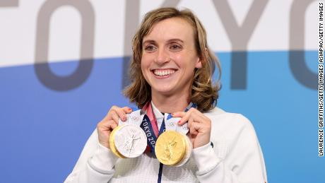 Ledecky poses with her two gold and two silver medals at the Tokyo Olympics.