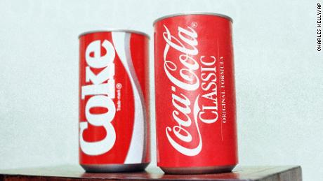 In this July 11, 1985 photo, cans of New Coke and Coca-Cola Classic are on display during a news conference in Atlanta.