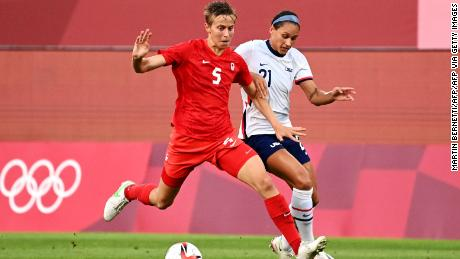 Canadian midfielder Quinn (in red) is the first trans and non-binary athlete to compete at the Olympics.