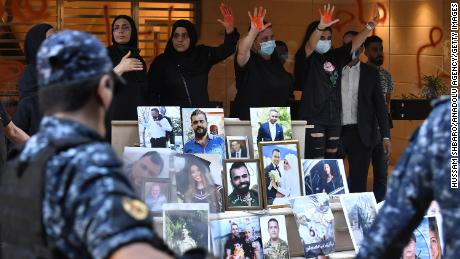 Relatives of the victims of Beirut Port blast gather in front of the house of Lebanon's Interior Minister, Mohammad Fahmi during a protest demanding the fair conduct of the investigation for the explosion in the Port of Beirut on Aug 4th in 2020,  in Beirut, Lebanon on July 13, 2021.